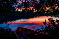The sun sets after a rains storm over Turtle Pond, in the St  Regis area of the Adirondacks in New York State, next to Saranac Lake