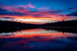 The sun sets after a rainstorm over Turtle Pond in the St  Regis area, near Saranac lake, in the Adirondack Mountains in New York State