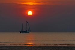 The sun sets on Mindi beach in Darwin, Australia