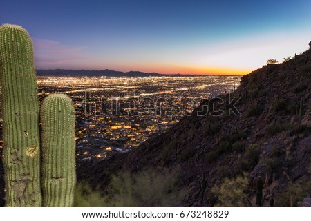 The sun sets on Phoenix on a spring night at Camelback Peak.