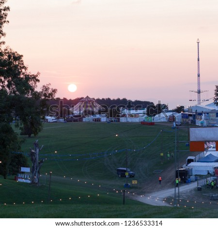 The sun sets on tents and marquees at a music festival #1236533314