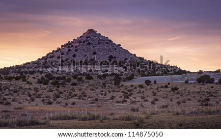 The sun sets on this pointy mountain/hill near Black Mesa in the Oklahoma panhandle. - stock photo