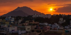 The Sun sets over a city in Tamil Nadu