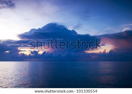 The sun sets over beach