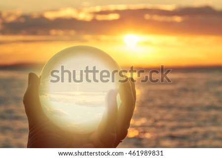 The sun sets over Lake Constance in Germany and lit by a crystal ball. #461989831