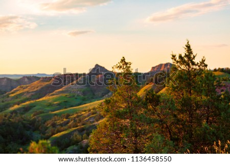 The sun sets over Scoria Point Overlook in Theodore Roosevelt National Park, North Dakota