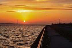 The sun sets over the Humber Bridge and Estuary on the eve of the forecasted storm Ciara,