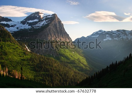 The sun sets over the mountains along Going to the Sun Road in Glacier National Park, Montana.