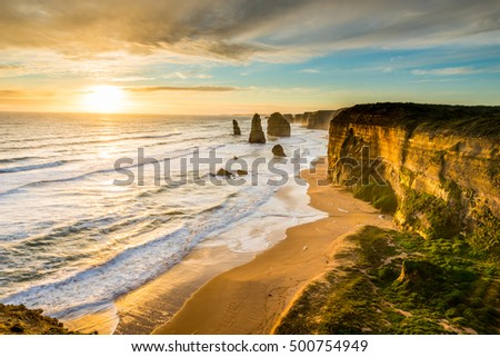 The sun sets over the Twelves Apostles on the Great Ocean Road, Australia.