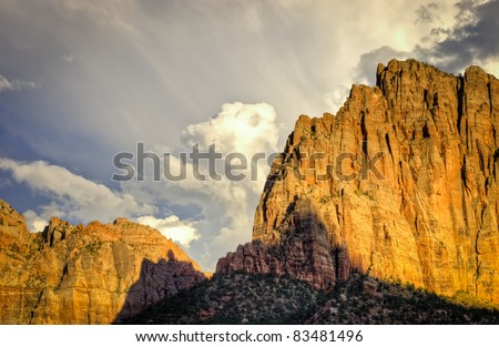 The sun setting over the entrance to Zion National Park.