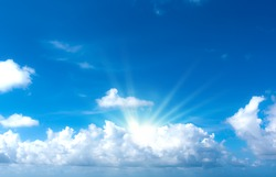 The sun shines bright in the daytime . Blue sky and clouds.