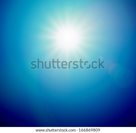 The sun shines bright in the daytime in summer. Blue sky. #166869809