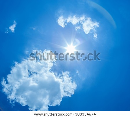 The sun shines bright in the daytime in summer. Blue sky and clouds. - Shutterstock ID 308334674