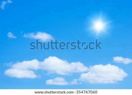The sun shines bright in the daytime in summer. Blue sky and clouds. #354767060