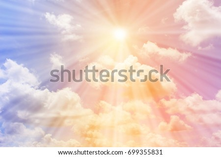 The sun shines on the pastel sky for background