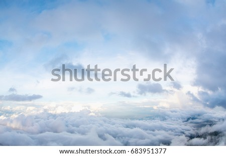 The sun shines on the sky from airplane, View on flight, bird eye view.Over the Clouds. Fantastic background with clouds and mountain peaks.rainbow on the cloud. rainbow in the heaven.