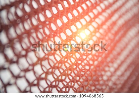The sun shines through the rusty grid, the texture of the grid for the background #1094068565