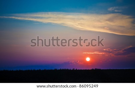 The sun shining over low cloud #86095249
