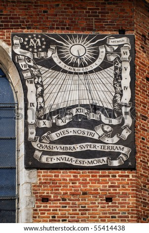 The sundial on the south wall of the nave of St. Mary's Church in Cracow. poland
