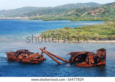 The sunken rusty ship near Roatan island (Honduras).