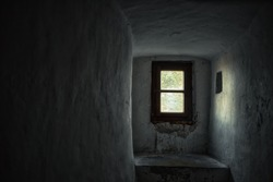 the sunlight entering through the small window of an old castle, interior, architecture wallpaper