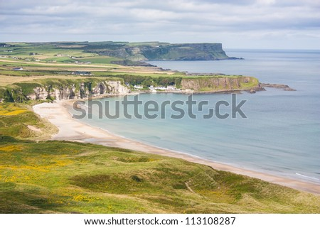The sunny coast and beach of nature reserve White Park Bay in Antrim Northern Ireland