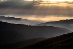 The sunrays above mountains in the early morning, Bieszczady Mountains, Poland