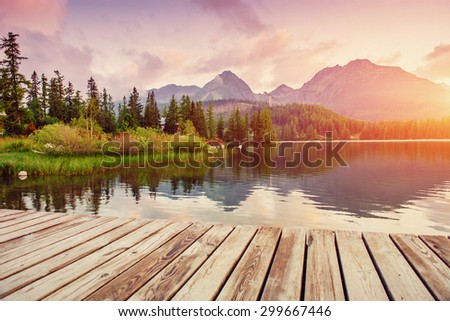 the sunrise over a lake in the...