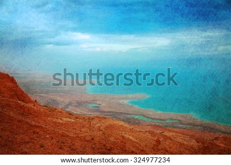 The sunrise view on the shoreline of Dead Sea under heavy clouds #324977234