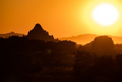 The sunset behind a mighty temple in the World Heritage Site of Bagan in Myanmar
