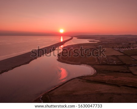 Photo of  The sunset over the Fleet in Weymouth, Dorset, UK