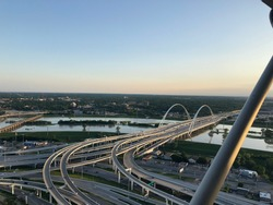 The sunset over the  Margaret McDermott Bridge and Trinity River in Dallas, Texas as seen from Reunion Tower.