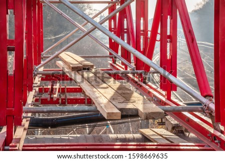 The supporting structure of scaffolding and beams at the reconstruction of the bridge
