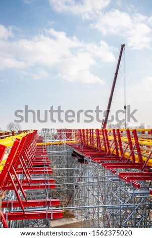 The supporting structure of scaffolding and wooden beams at the reconstruction of the bridge