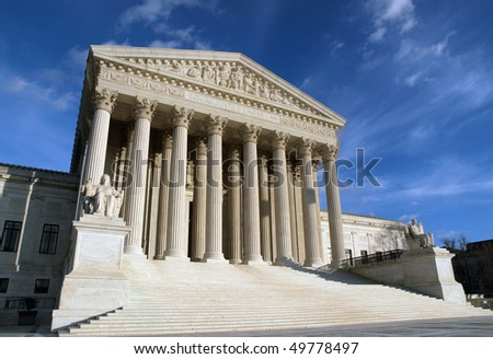 The Supreme Court building in Washington DC in warm afternoon light.