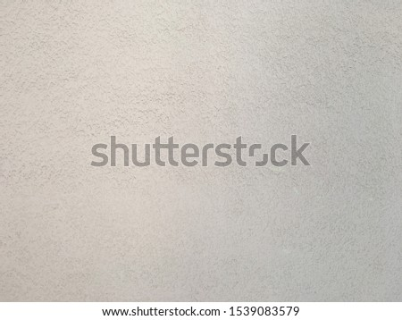 The surface has a white surface with a rough surface. #1539083579
