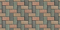 The surface is lined with colorful road tiles - paving stone. View from above. Specially prepared background for seamless shading.