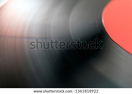 The surface of a vinyl record. Close up of vinyl surface. Vinyl record texture background. Close up of vinyl record showing grooves #1361818922