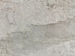 The surface of an unpainted concrete cement wall. Rough texture wall.
