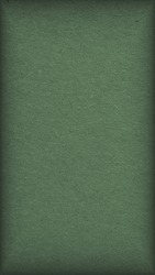 The surface of dark green cardboard. Paper texture with cellulose fibers. Paperboard mobile phone wallpaper with vignetting. Narrow vertical background. Modern, futuristic, elegant autumn color. Macro