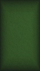 The surface of dark green cardboard. Paper texture with cellulose fibers. Paperboard mobile phone wallpaper with vignetting. Narrow vertical background. Glamorous and elegant autumn color. Macro