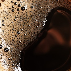 The surface of the hot coffee. Abstract background. macro