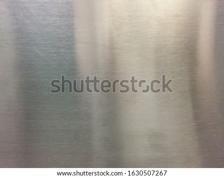 The surface of the metal or sheet metal background