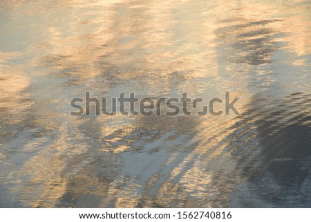 The surface of the river water is refracted with sunlight reflecting the sunlight very beautiful. #1562740816