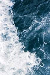 The surface of the sea with waves,  splash,  foam and bubbles at high tide, aqua abstract background