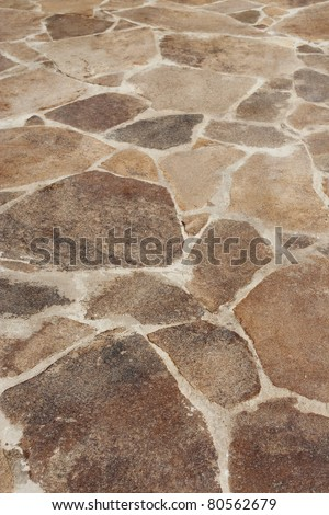 The surface of the stone floor on the terrace. Background, texture