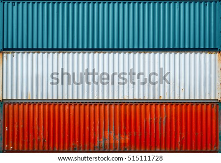 The surface texture of the sea container.Three containers without labels.