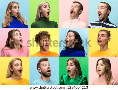 The surprised and astonished young woman and man screaming with open mouth isolated on colorful background. concept of shock face human emotion #1254004213