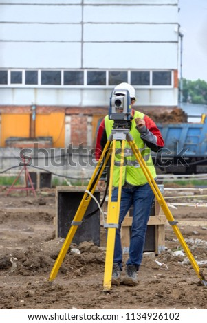 The surveyor makes measurements for the cadastre