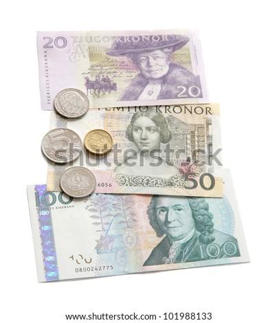 The Swedish money close up on a white background.